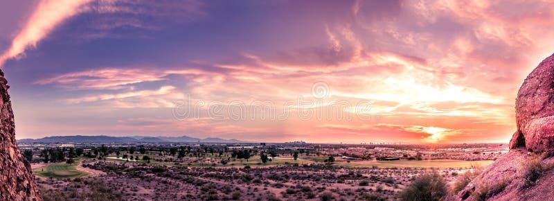 Panorama sunset late evening Phoenix,Arizona. Panorama of sunset over late evening red sky over Phoenix,Arizona. Papago Park buttes in foreground stock image