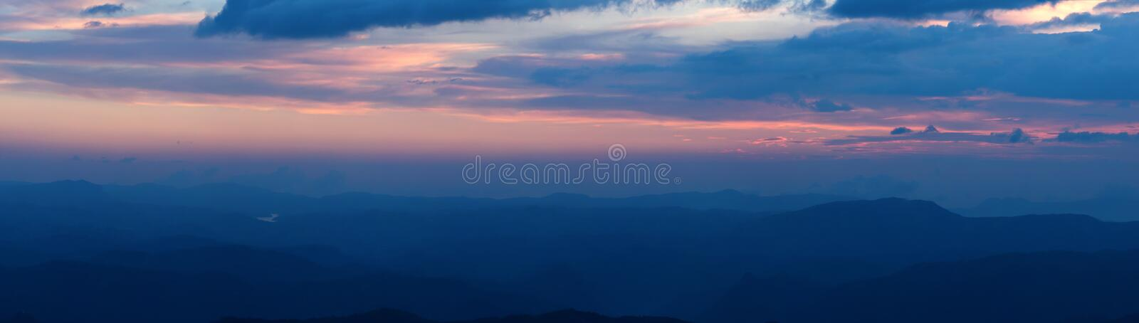Panorama of sunset in mountains stock photography