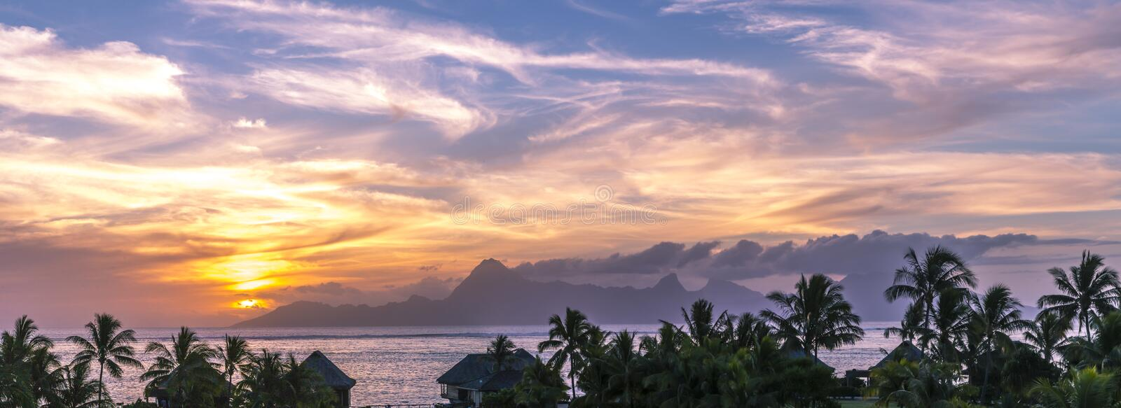 Tahiti Sunset Panorama. Panorama sunset view of the island of Moorea in French Polynesia as seen from Tahiti royalty free stock photography