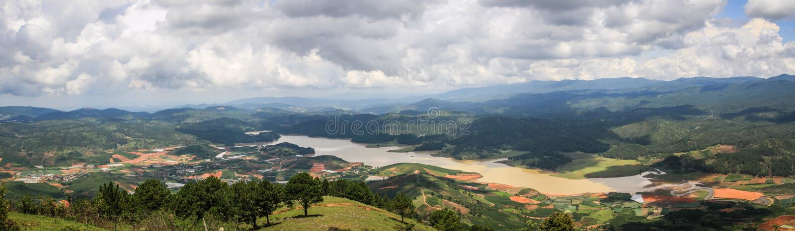 Panorama on the surrounding countryside from the Lang Biang Mountain, Lam Province, Vietnam. Lang Biang consists of the two highest peaks of Lam Vien Highland stock images