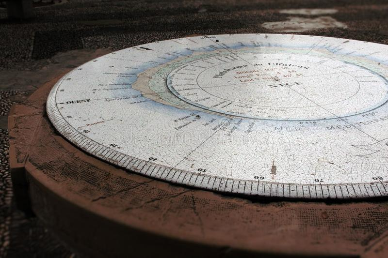 Panorama table with compass tourists attraction place in France. Panorama table with compass tourists attraction place, blue, brown, cracks, dark, directions royalty free stock photo