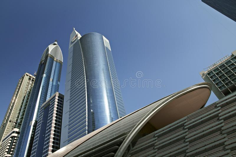Skyscrapers in skyline of Dubai against blue sky stock images