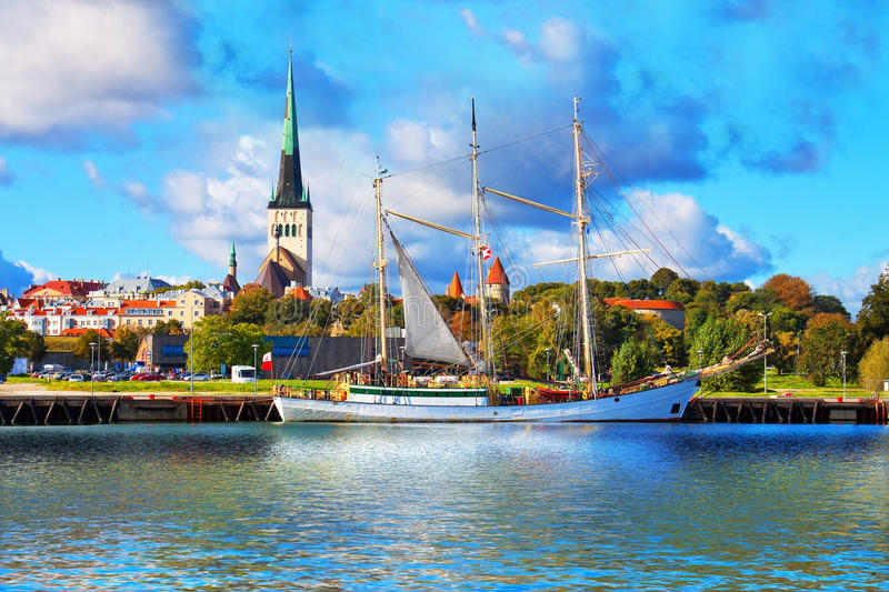 Panorama of Tallinn, Estonia. Scenic summer panorama of pier with historical tall sailing ship in the Old Town in Tallinn, Estonia royalty free stock photo
