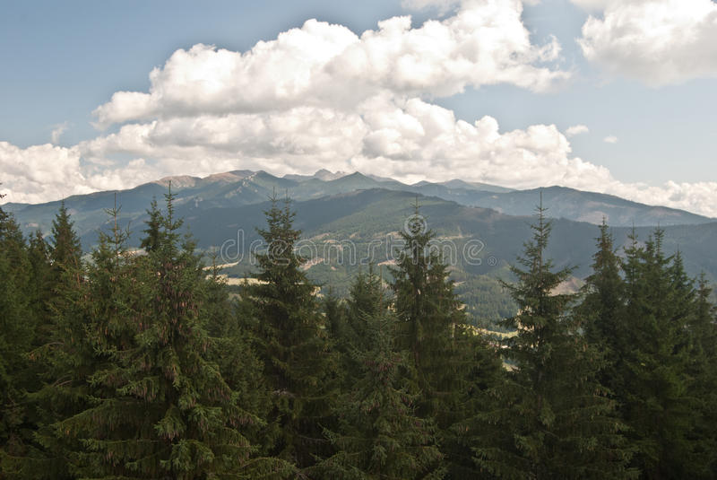 Panorama of Tatry mountains from wooden lookout on Susava hill. Paorama of Tatry mountains from wooden lookout on Susava hill above Velke Borove village in stock photo