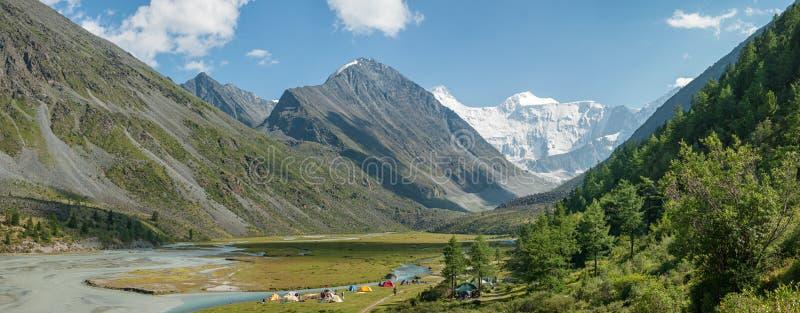 Panorama of the tent camp near the lake Akkem stock photo