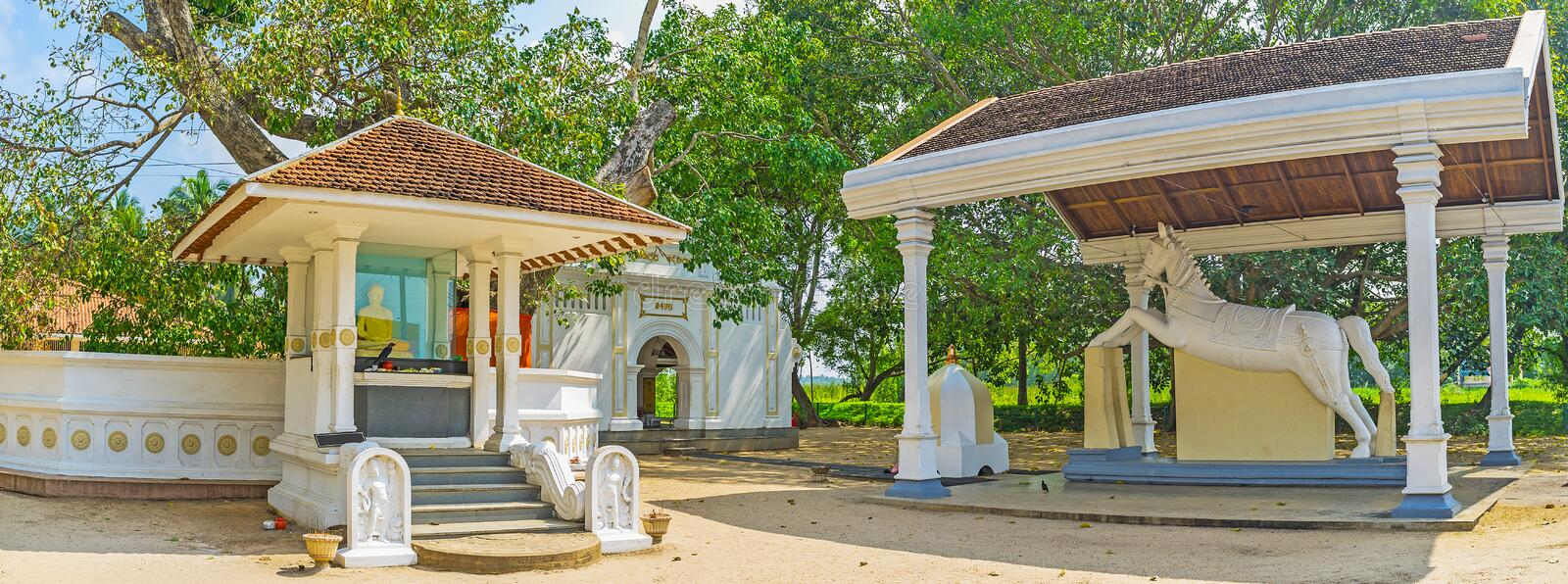Panorama of Thaniwalla Devalaya Temple. With Buddha altar at the Bodhi Tree, Shrine and the white horse statue, Madampe, Sri Lanka stock photos