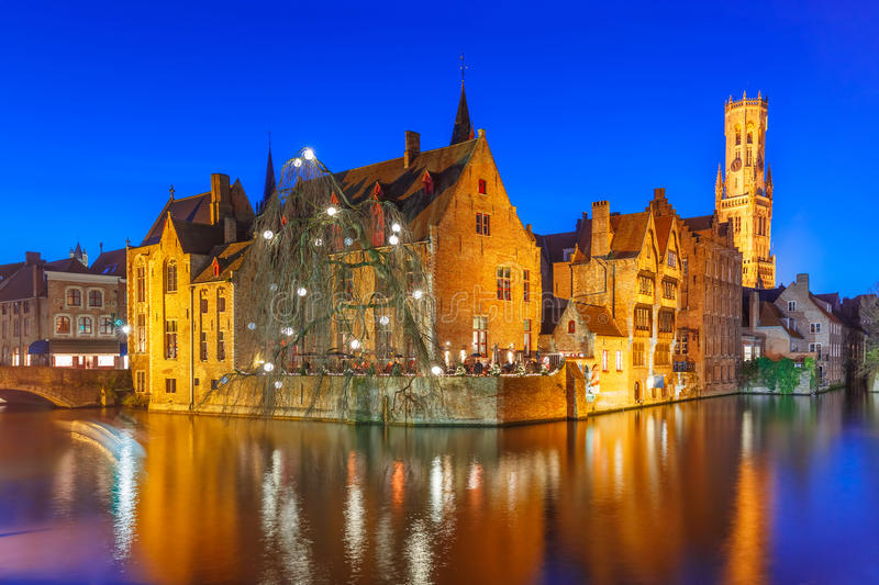 Panorama with tower Belfort in Bruges, Belgium. Scenic panorama with medieval fairytale town and tower Belfort from the quay Rosary, Rozenhoedkaai, in the royalty free stock photography