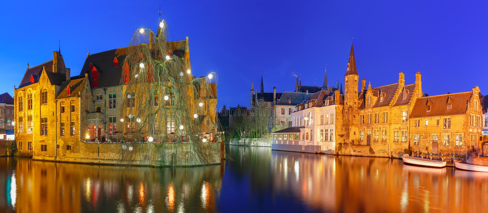 Panorama with tower Belfort in Bruges, Belgium. Scenic panorama with medieval fairytale town and tower Belfort from the quay Rosary, Rozenhoedkaai, at night stock image