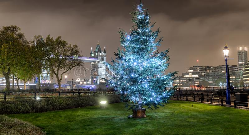 Panorama of the Tower Bridge in London with a Christmas tree stock photo