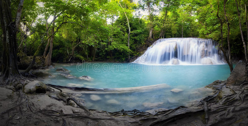 Panorama of tropical forest, waterfall and small pond stock photo