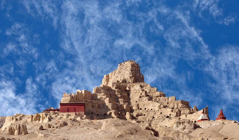 Panorama of Tsaparang palace in Guge Kingdom, Tibet. Panorama of Tsaparang, the ruins of the ancient capital of Guge Kingdom and Tholing Monastery at sunset in royalty free stock image