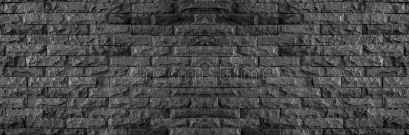 Panorama van zwarte bakstenen muur van donkere steentextuur en achtergrond royalty-vrije stock afbeeldingen