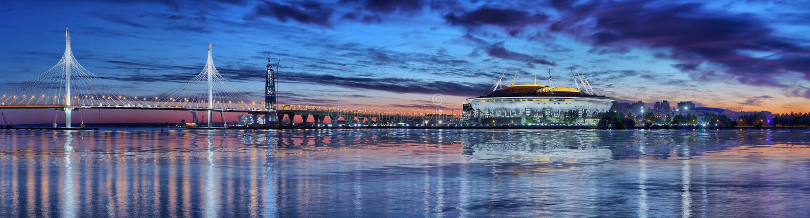 Panorama of Vantovy Bridge, stadium Zenit Arena in St. Petersburg. Large-format panorama of Vantovy Bridge, stadium Zenit Arena and towers at sunset in St stock photos