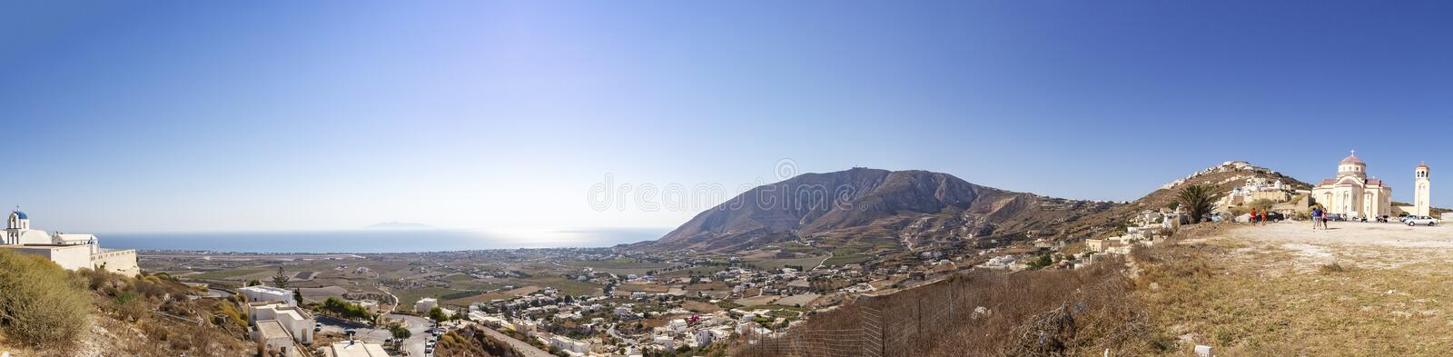 Panorama view from Agios Charalambos on the eastern side of Santorini with the airport and the city Kamari stock image