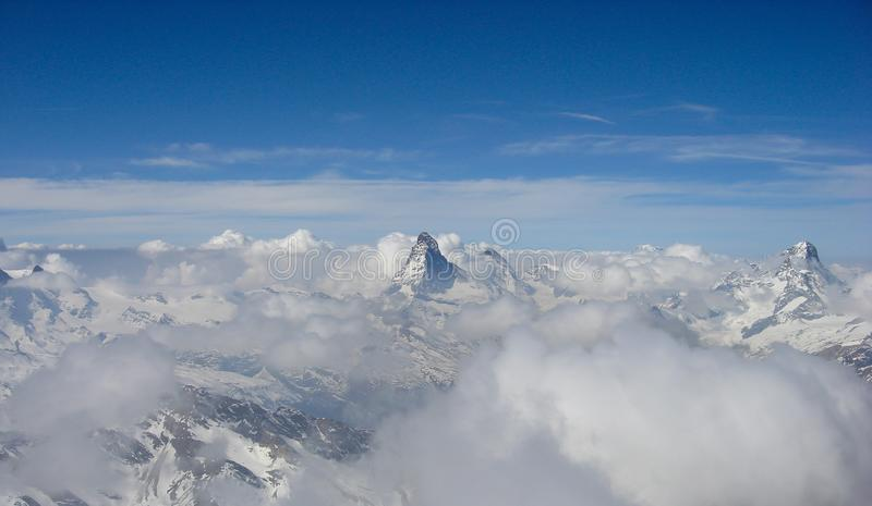 Panorama view of the Alps near Zermatt above a sea of clouds with the famous Matterhorn and Dent Blanche peeking out above the clo stock images