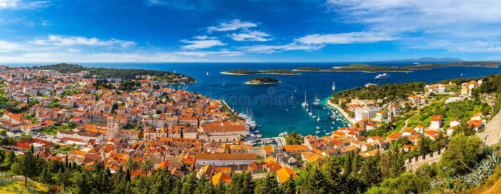 Panorama view at amazing archipelago in front of town Hvar, Croatia. Harbor of old Adriatic island town Hvar. Amazing Hvar city on royalty free stock photo