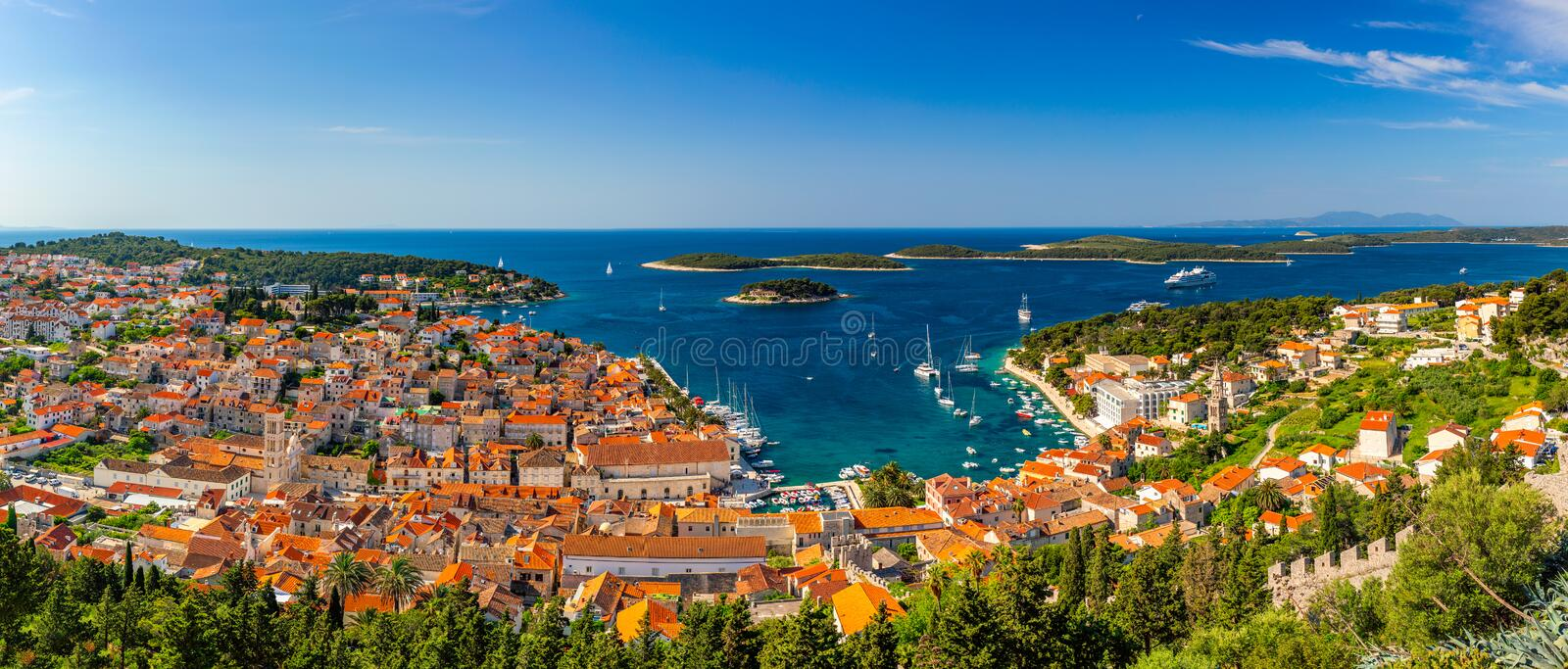 Panorama view at amazing archipelago in front of town Hvar, Croatia. Harbor of old Adriatic island town Hvar. Amazing Hvar city on stock photos