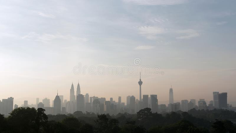 Panorama view of beautiful kuala lumpur cityscape skyline in the hazy or foggy morning enviroment royalty free stock photography
