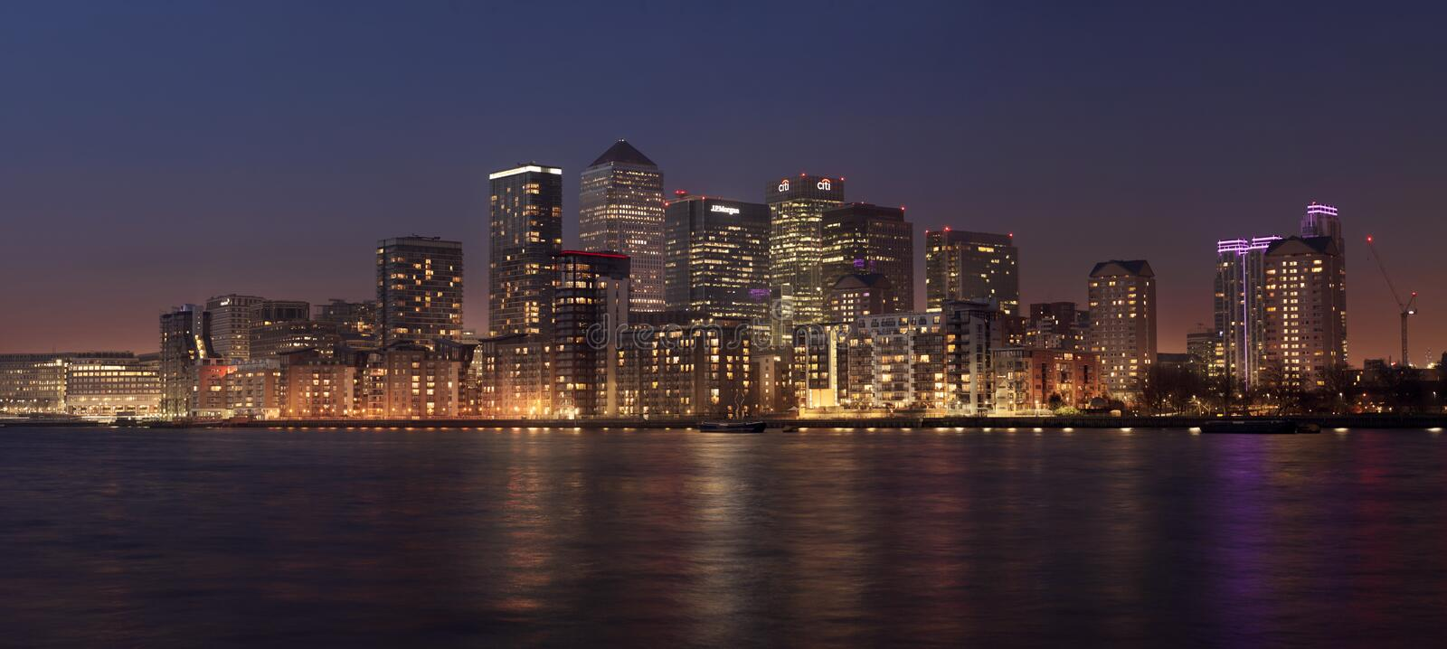 Panorama view of Canary Wharf district at dusk