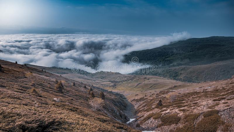 Panorama view of colorful mountains and valley with clouds. Early morning,  Sharr Mountains, Popova Shapka, North Macedonia stock photo