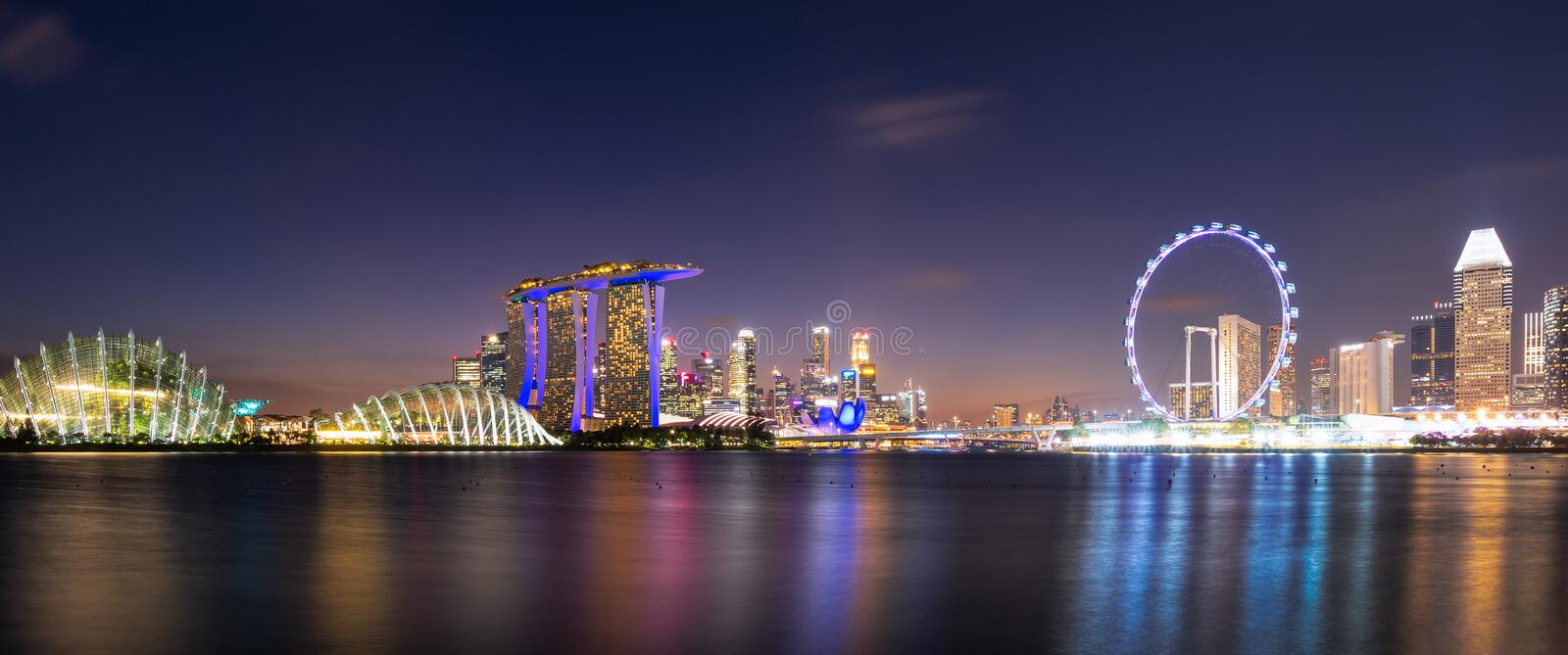 Panorama view of downtown business buildings area at night in Singapore stock image
