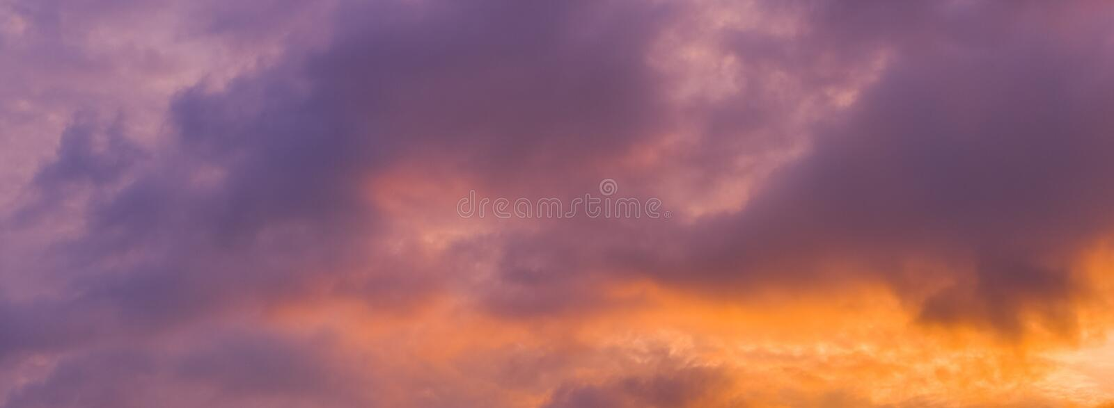 Panorama view of dramatic beautiful nature sunset sky and clouds. Background royalty free stock image