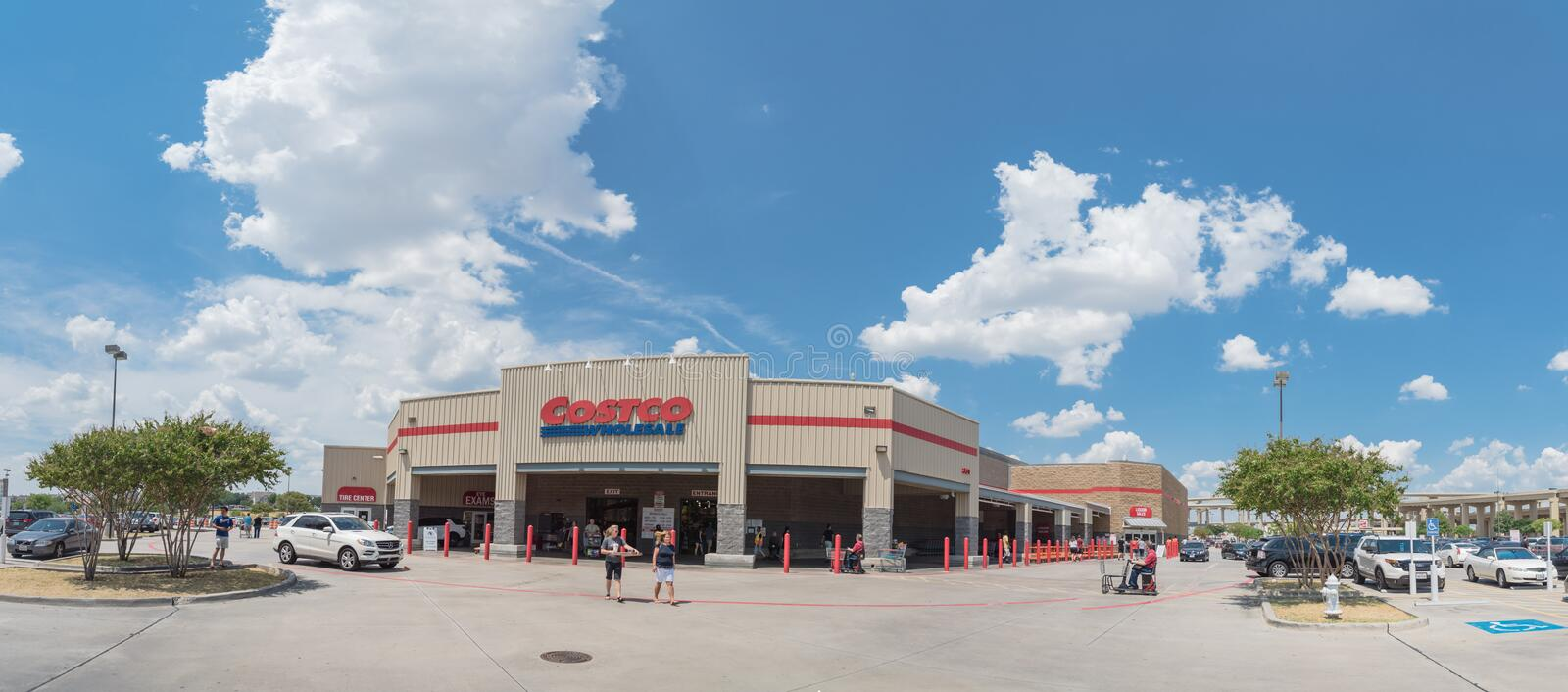 Panorama view entrance to Costco Wholesale store in Lewisville,. Lewisville, TX, USA-AUG 4, 2018:Panorama entrance Costco Wholesale storefront and liquor store stock image