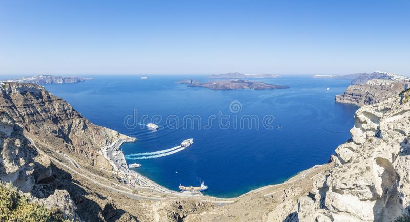 Panorama view of the Ferry port and the rocky side of the island Santorini, Greece royalty free stock photos