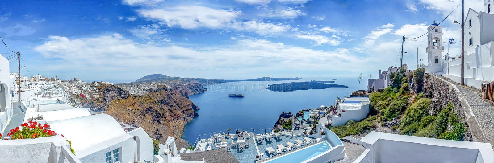 Panorama view from Imerofigli to Fira with the cruise ship waiting by the harbour, Santorini, Greece stock photography
