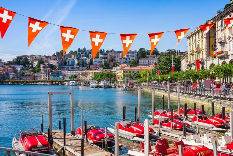 Panorama view of the lake Lugano, mountains and city Lugano, Ticino canton, Switzerland. Scenic beautiful Swiss town with luxury stock image