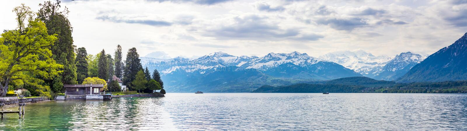Panorama view in lake Thun and view of Bernese Alps mountain Berne, Switzerland. Europe royalty free stock image