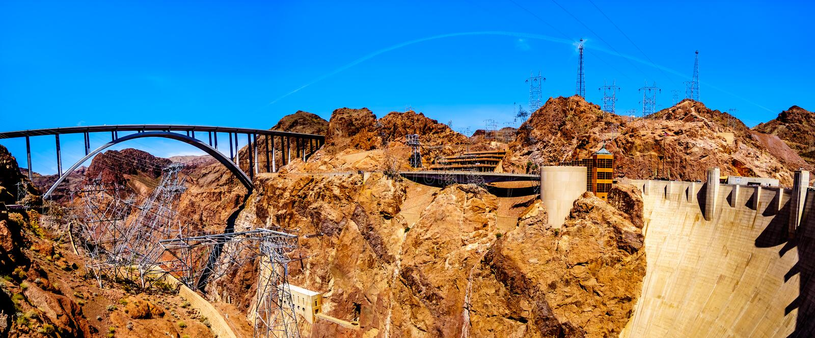 Panorama view of the Mike O`Callaghan–Pat Tillman Memorial Bridge that crosses the Colorado river and the Hoover Dam. The bridge connects the states of royalty free stock images