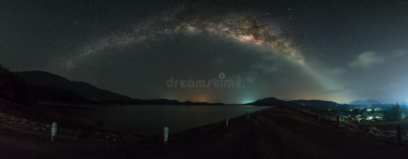 Panorama view of milky way galaxy over the dam.  royalty free stock images