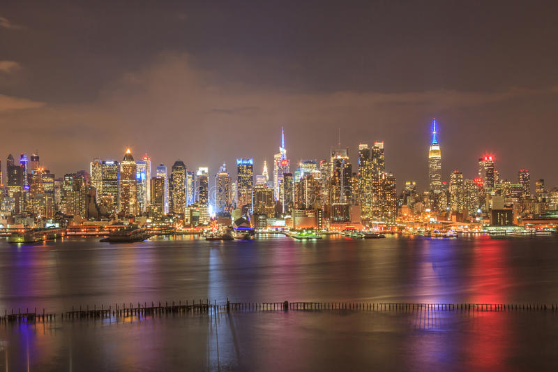 Panorama view of New York City skyline midtown Manhattan in nigh royalty free stock photos