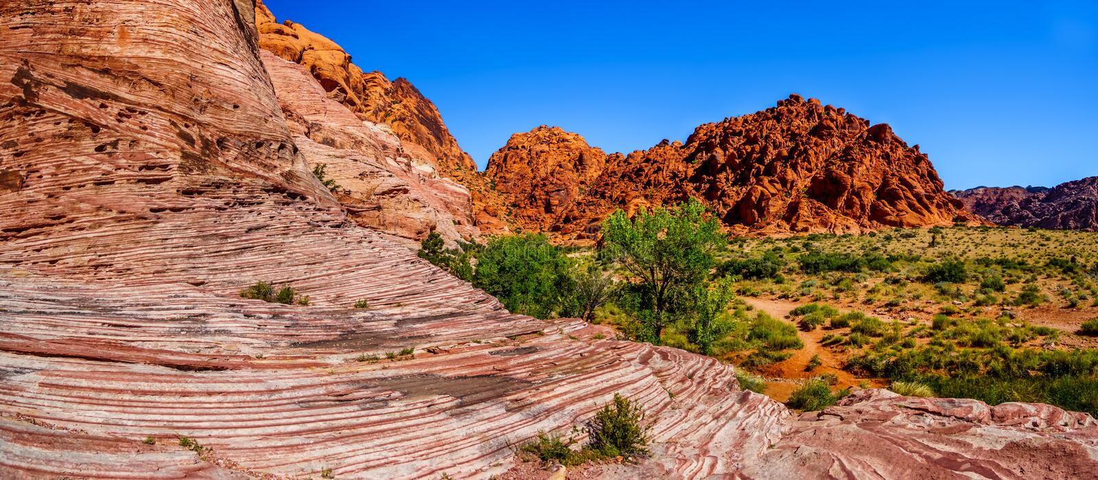 Panorama View of the Red Sandstone Mountains from the Trail to the Guardian Angel Peak in Red Rock Canyon stock image