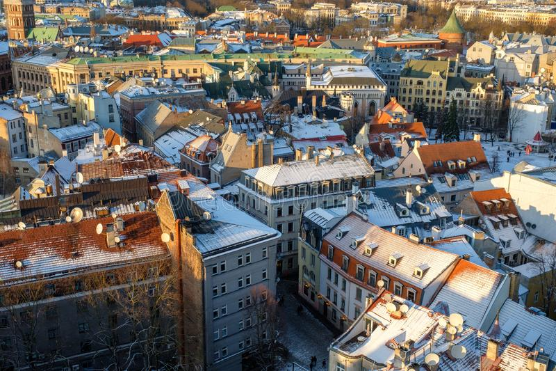 Panorama view of Riga Old Town, Latvia in winter day. Aerial view from St. Peter`s cathedral on snowy roofs and medieval streets royalty free stock images
