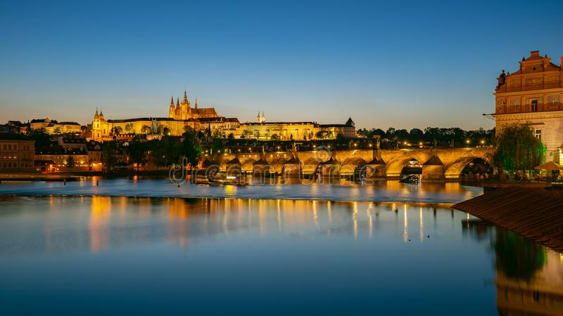 Panorama view of Saint Vitus Cathedral with Prague city skyline at night in Prague, Czech Republic stock photography
