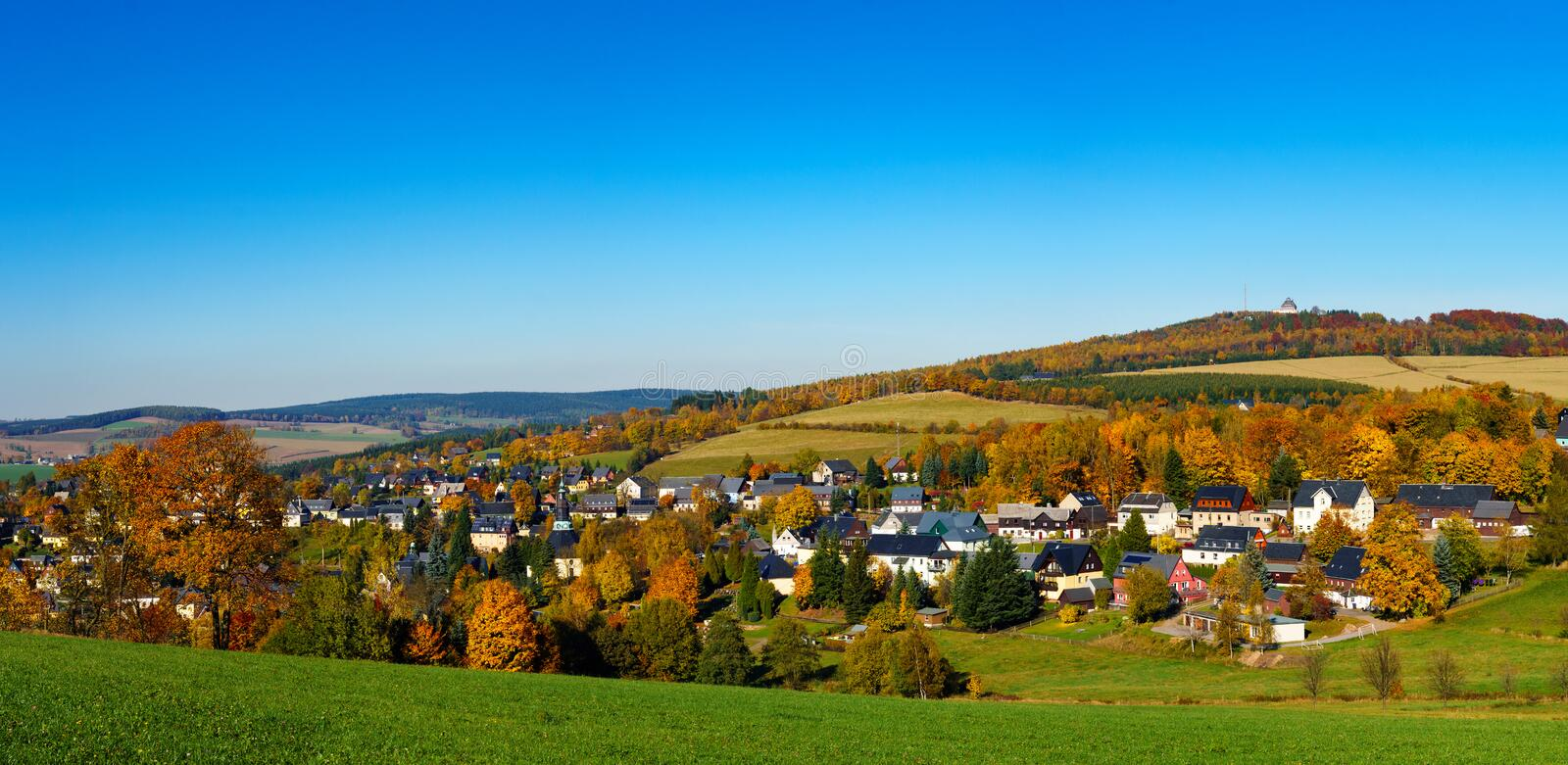 Panorama view Seiffen in Autumn . Saxony Germany ore mountains with blue sky royalty free stock photo