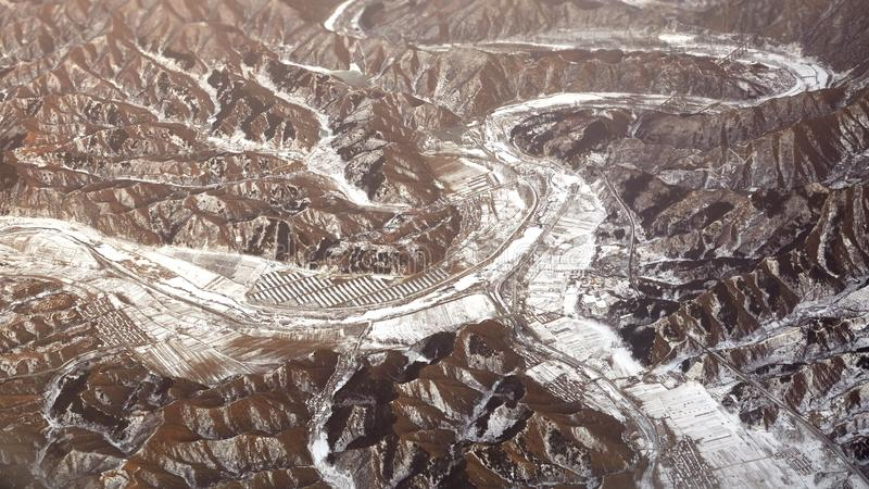 Panorama view of snow mountains and villages. Village winter in deep mountain, northern China landscape stock image