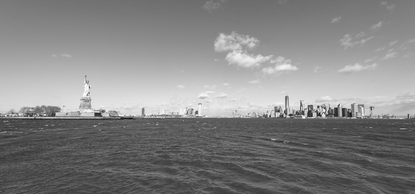 Panorama View of Statue of Liberty at New York City with Manhattan Skyline over Hudson River - USA royalty free stock photos