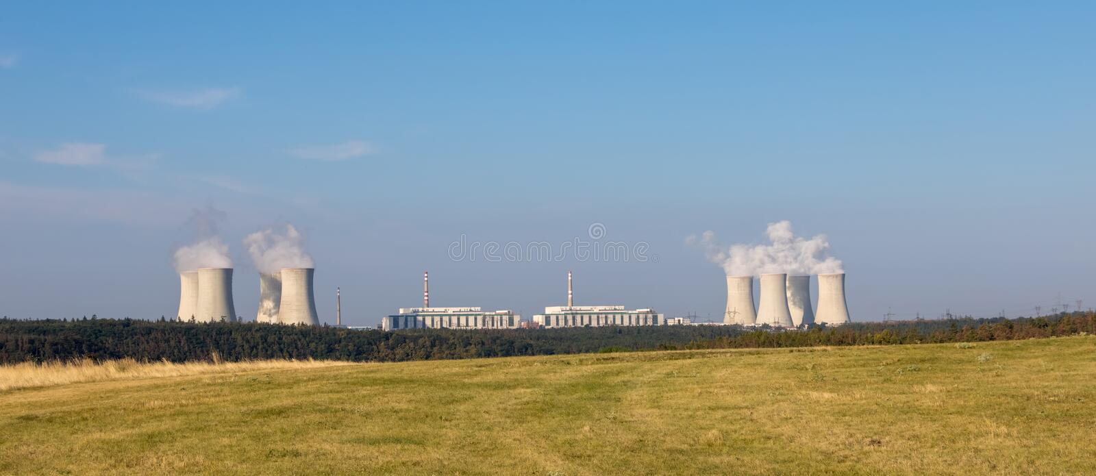 Panorama view of summer landscape with nuclear power plant. On horizon. Dukovany village, Czech Republic, Europe royalty free stock image