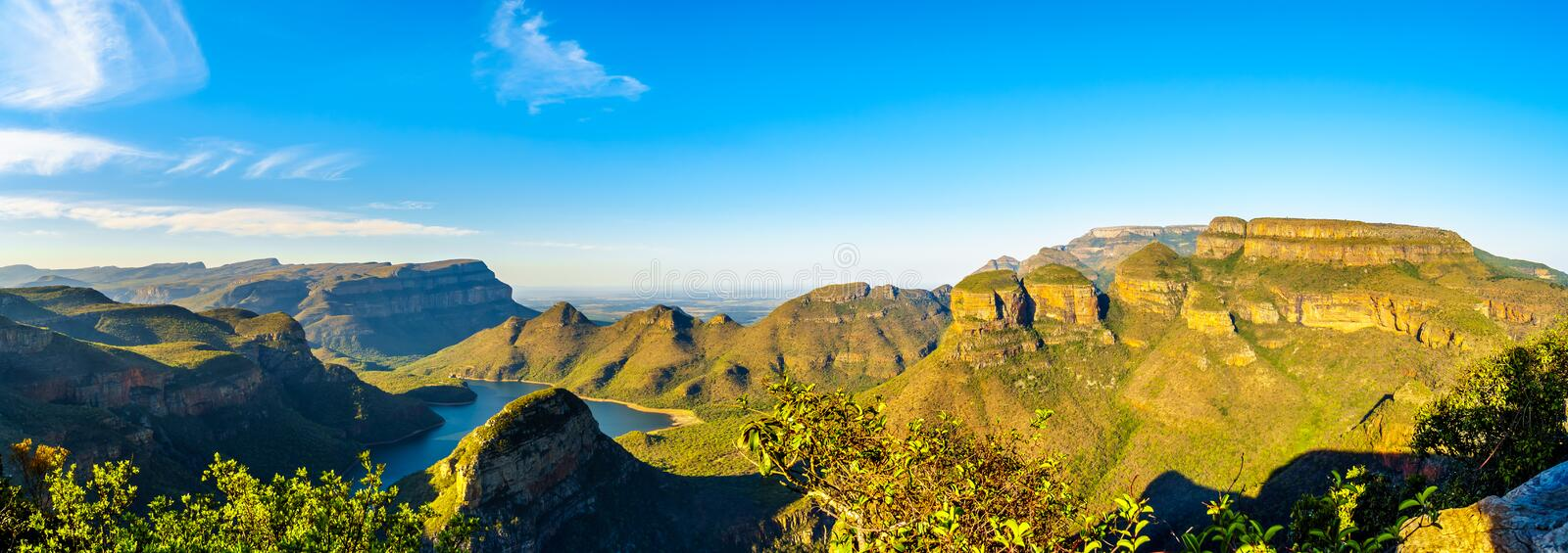 Panorama view of a Sunset over Blyde Caniyon Dam and the three Rondavels of Blyde River Canyon Nature Reserve royalty free stock photo