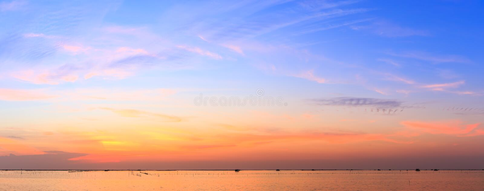 Panorama view of sunset over shell farm stock photos