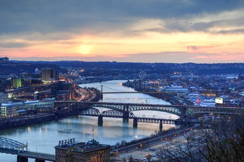 Panorama View of Suspension Bridge Connecting Urban City during Golden Hour stock photography