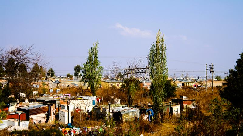 Panorama view to soweto favela outskirt of Johannesburg, South A. Panorama view to soweto favela outskirt - 25 august 2013 Johannesburg in South Africa stock images
