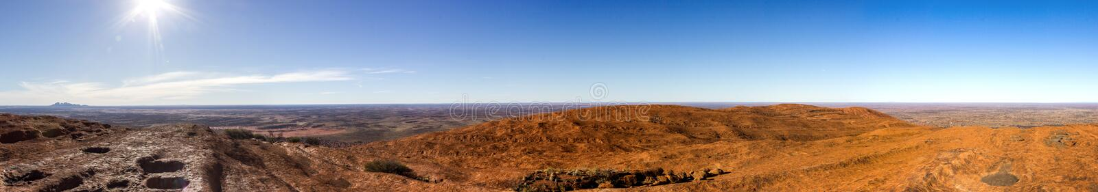 panorama view from the uluru after hiking up the Uluru with kata tjuta in the distance, ayers Rock, the Red Center of Australia, stock photography