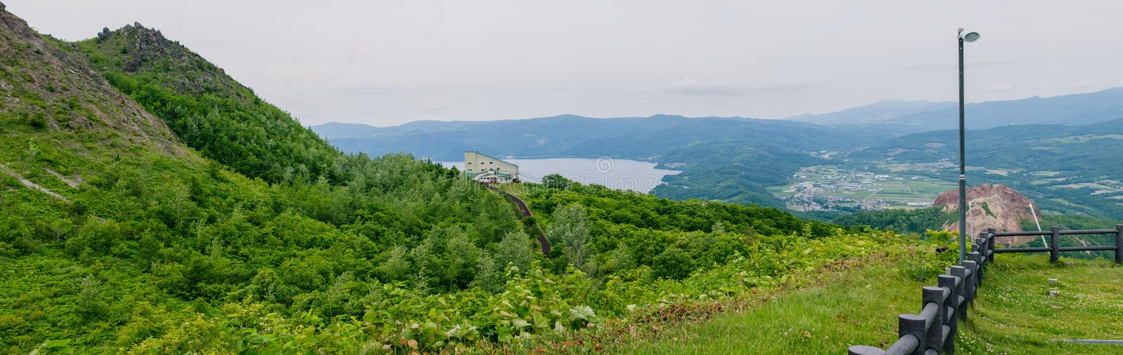 Panorama view from Viewpoint on Usu mountain at Hokkaido, Japan. This place include Showa Shinzan mountain and part of Lake Toya. Panorama view from Viewpoint stock photography