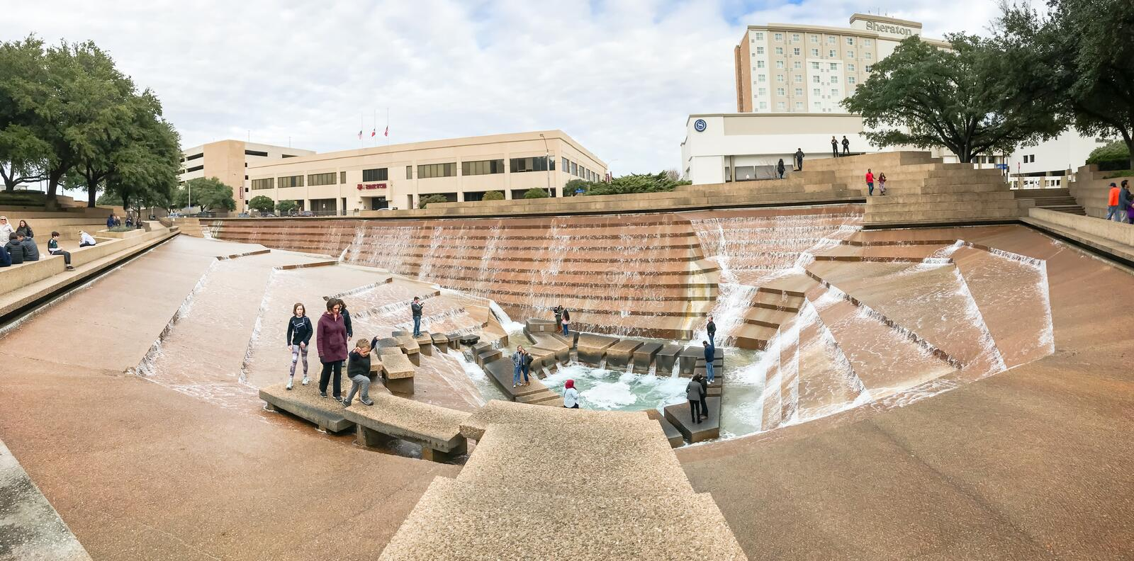 Panorama view Water Gardens in downtown Fort Worth with visitors. FORT WORTH, TX, US-DEC 24, 2018:Panorama view Water Gardens in downtown Fort Worth with stock image