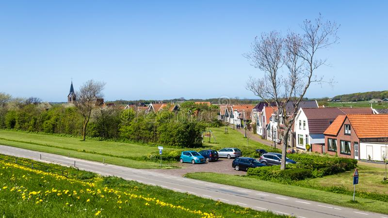 Village Oudeschild on Texel island in the Netherlands. Panorama Village Oudeschild with Martinus church and trraditional gable houses on the Wadden island Texel royalty free stock image