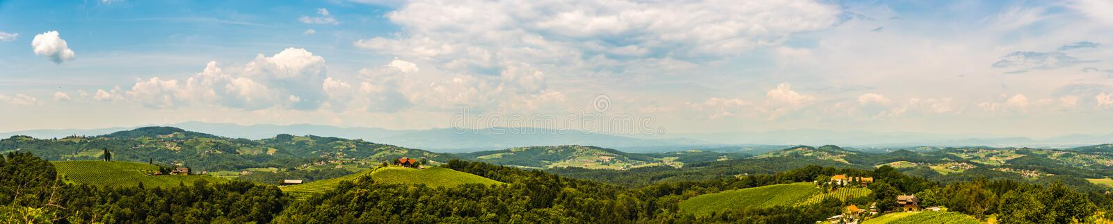 Panorama of Vineyards in south styria in Austria. Landscape of Leibnitz area from Kogelberg. Tourist destination, Green hills of grape crops and mountains royalty free stock image